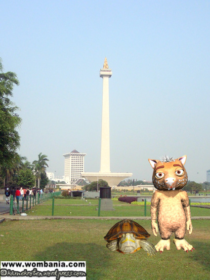 Fraz and Kroten standing in front of Jakarta's Landmark, Monas by Novia