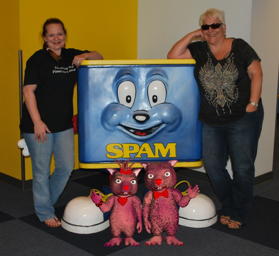 Red and Val, and Claret and Bruno pose with Spammy